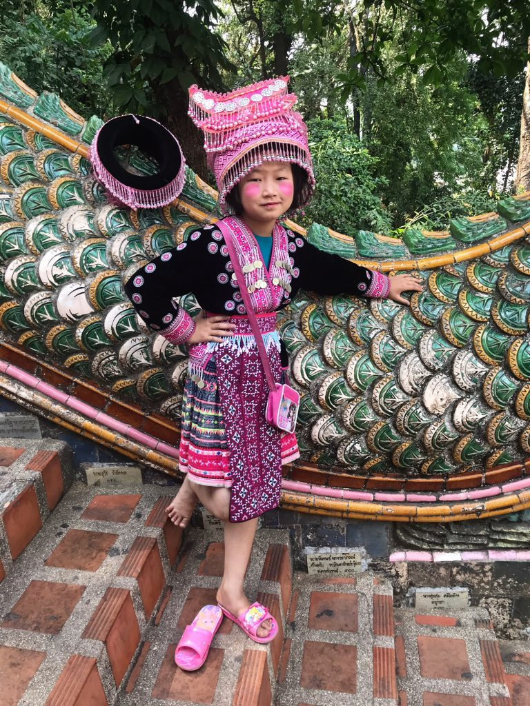 Akha-Hill-Tribe-girl-on-the-serpentile-staircase-at-Doi-Suthep-768x1024
